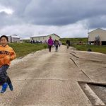 Excited Newtok children sprint down temporary roads in Mertarvik, the site where the village hopes to relocate. (Photo: Christine Trudeau/KYUK)